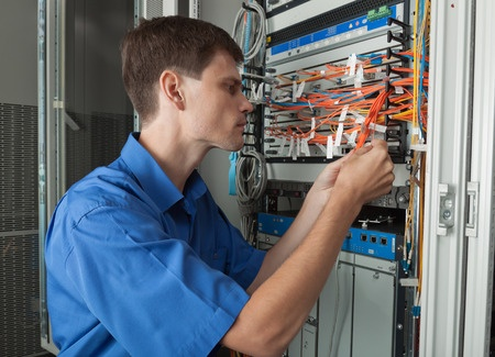 2-INSTALLATION SVCS_Wiring Tech in Cabinet_25612940_s.jpg