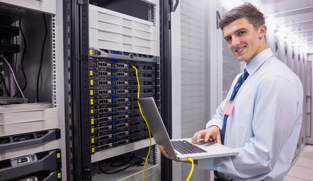 4-REPLACEMENTS-UPGRADES_Smiling Tech Updating Server_31910141_s.jpg
