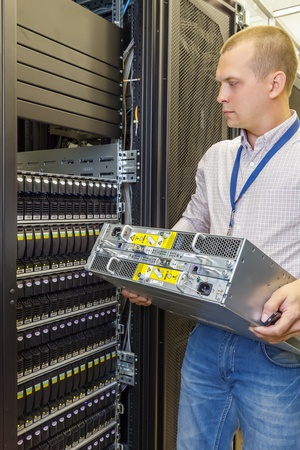 4-REPLACEMENTS-UPGRADES_Tech Installing Server_49538085_s.jpg