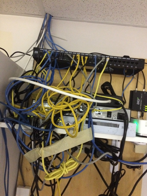 Tech Service Today IT Disaster of the week photo of network cables managed with masking tape