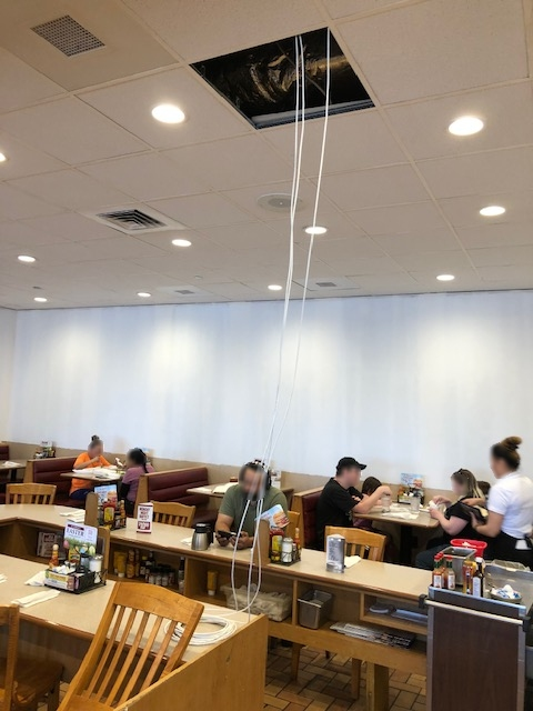 Tech Service Today (TST) IT disaster of network cabling hanging from a restaurant ceiling